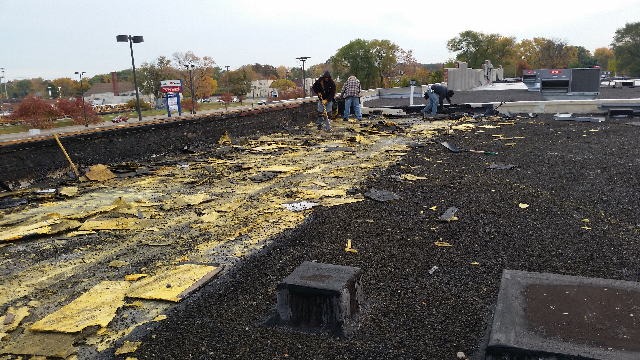 Roofing repair in progress