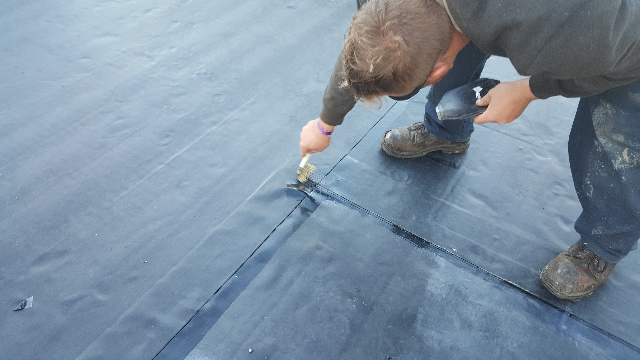 Installing and fully adhering the new EPDM.